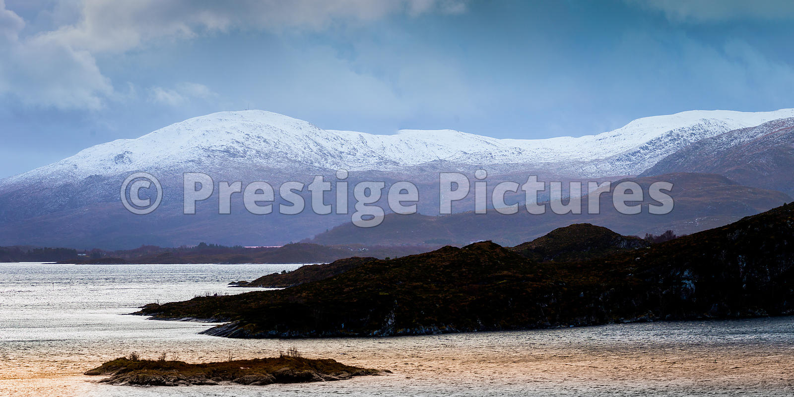 Landscape of Snow-Capped Mountains and Coastline near Herøy, Norway