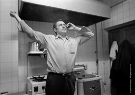 #75046  In the kitchen, George Shields stretching, Liverpool Free School, Liverpool  1971.  Also known as the Scotland Road o...