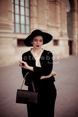 A vintage 1950's woman in a hat.