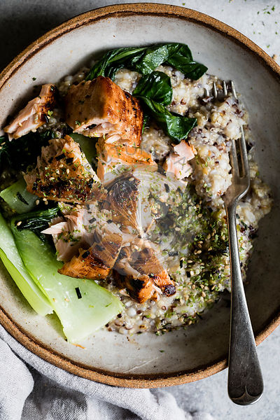 A healthy multigrain porridge with a savoury topping of miso roasted salmon and bok choy