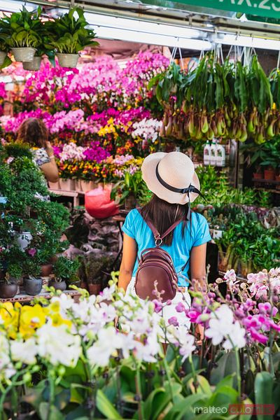 Woman at flower market, Hong Kong, China