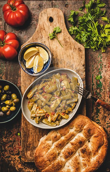 Turkish traditional starter braised green beens with vegetables and flatbread