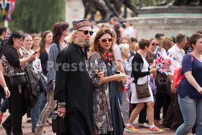 Man and Woman in Kaftans walking towards Buckingham Palace after Trooping the Colour Ceremony