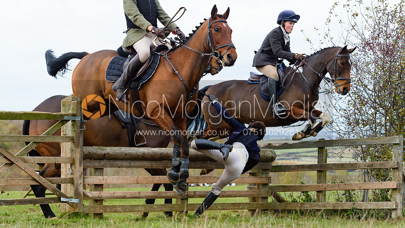 Ida Thore, Max Kettlewell jumping a hunt jump at Stone Lodge. The Cottesmore Hunt at Tilton