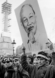 #70423,  Protesting student holds a placard of Ho Chi Minh, President of the Democratic Republic of Vietnam (North Vietnam), ...