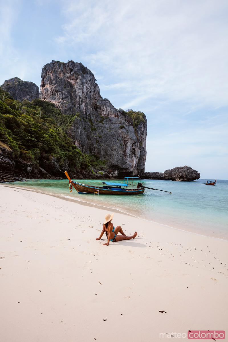 Asian woman relaxing on beach, Ko Phi Phi island, Krabi, Thailand