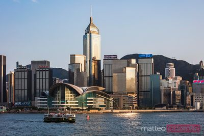 Ferry in Victoria harbour and skyline, Hong Kong