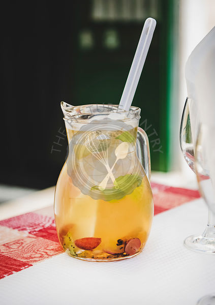 Jug of fresh cold white wine Sangria with fruit
