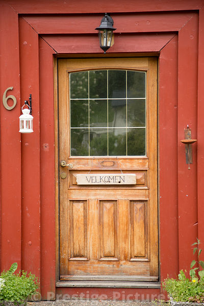 Traditional Wooden Front Door to House with Welcome SIgn