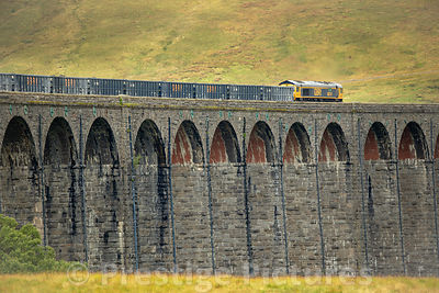 Freightliner Heavy Haul Class 66 diesel train crossing the Ribblehead Viaduct