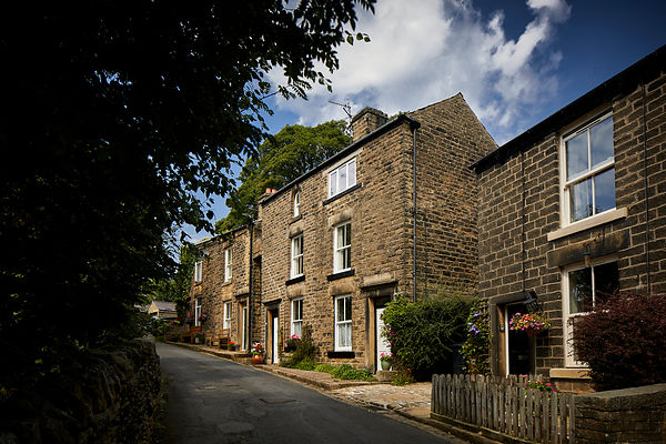 Hayfield village, High Peak, Derbyshire, typical 3 story houses on `Spring Vale Road