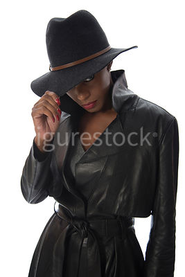 A tough woman, in a leather coat – shot from eye level.