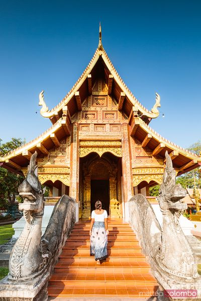 Woman walking to the temple, Wat Phra Singh, Chiang Mai, Thailand