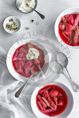 Stewed rhubarb and strawberries served in bowls.