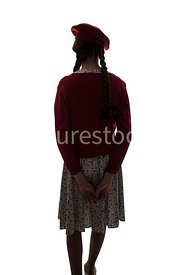 A silhouette of a 1940's girl in a dress and beret  – shot from eye-level.