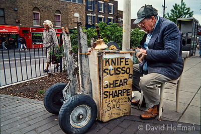 34-131 Itinerant knife grinder, Bethnal Green, around 1980.