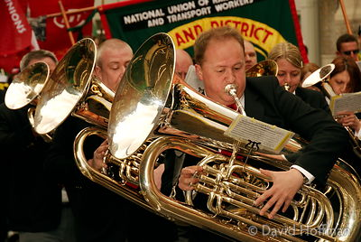 Brass band on Mayday demonstration and march, Clerkenwell, London.