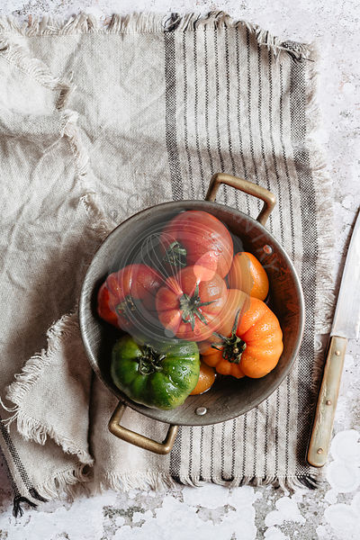 Beautiful colorful tomatoes into a small pot