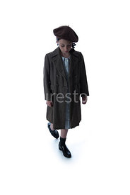 A semi-silhouette of a 1940's child evacuee, in a big coat – shot from eye level.