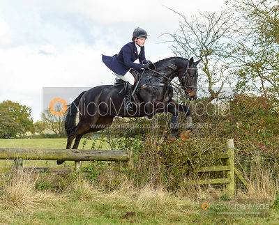 Meghan Healy jumping a fence at Cheseldyne - Cottesmore Hunt Opening Meet 2019