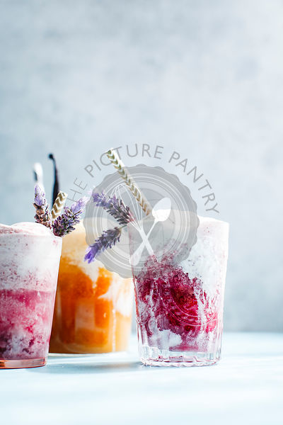 Various Ice cream floats with lavender and straws