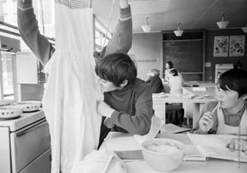 #83635,  Boys sorting out their aprons for cooking class, Whitworth Comprehensive School, Whitworth, Lancashire.  1970.  Shot...