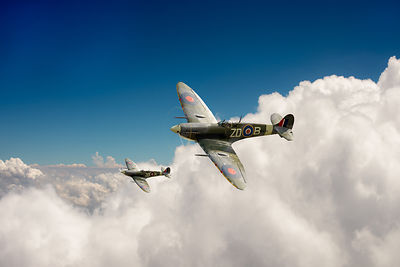 222 Squadron Spitfires above clouds