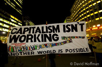 "A range of anti-capitalist and anarchist groups gathered at Canary Wharf for a Halloween party to ""dance on capitalism's grave""."