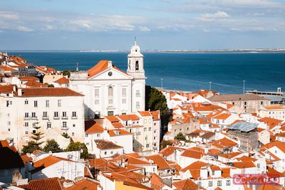 Elevated view of church and old town, Lisbon, Portugal