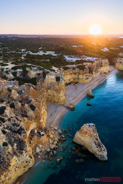 Drone view of Praia de Marinha at sunrise, Algarve, Portugal