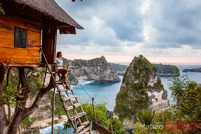 Woman at treehouse, Nusa Penida, Bali, Indonesia
