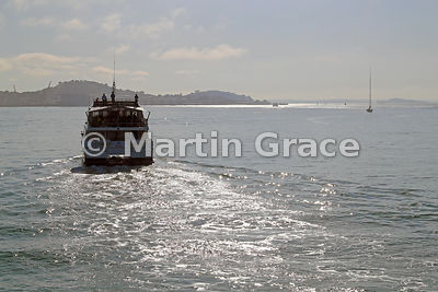 Tourist vessel sailing out into Hauraki Gulf from Waitemata Harbour, Auckland, North Island, New Zealand