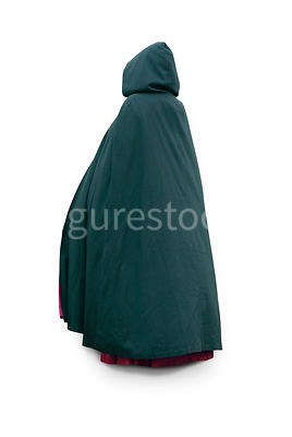 A hooded mystery woman in a big cloak walking away – shot from mid level.