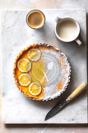 Lemon tart and a cup of coffee on the table