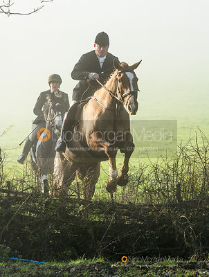 Ian Arthur jumping a hedge at Withcote - The Cottesmore Hunt at Withcote 30/11