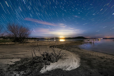 A moonlit scene where stone, sand, and water merge into a perfect combination