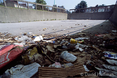 Rubbish dumped on 'playground area' of housing estate, East London.
