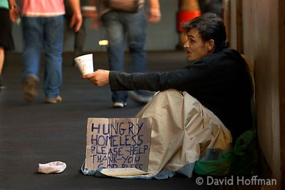 Homeless heroin addict begging from commuters in London Bridge station.
