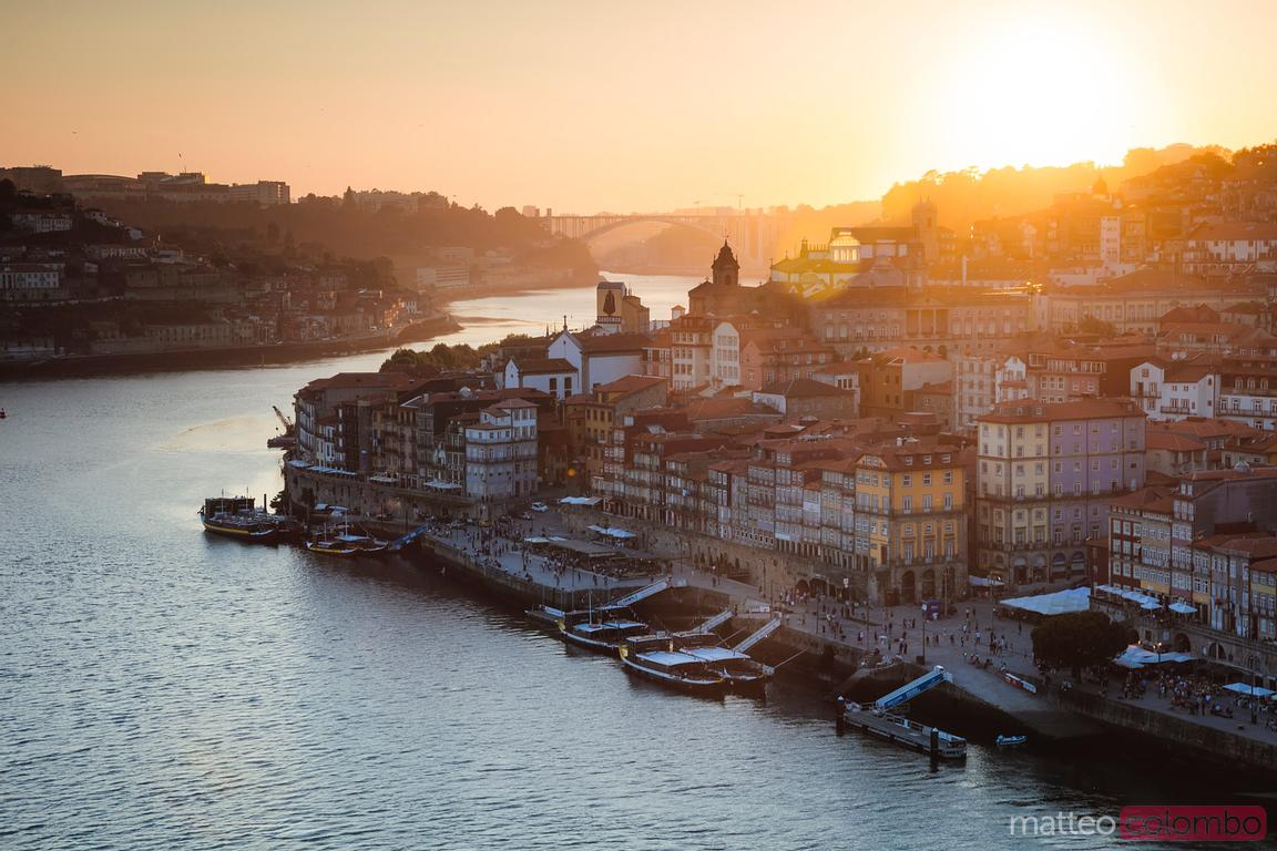 Golden sunset over Ribeira district, Porto, Portugal