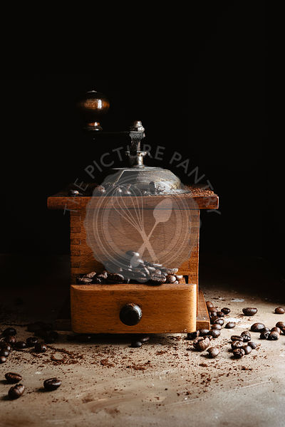 Coffee into a coffee grinder