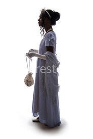 A silhouette of a Regency woman in a dress – shot from eye level.