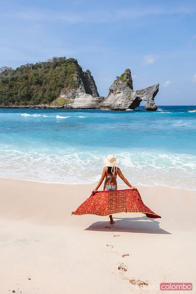 Woman with sarong at the beach, Nusa Penida, Bali