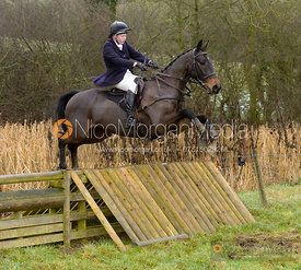 Meghan Healy jumping a hunt jump at Peakes - The Fitzwilliam Hunt visit the Cottesmore at Burrough House