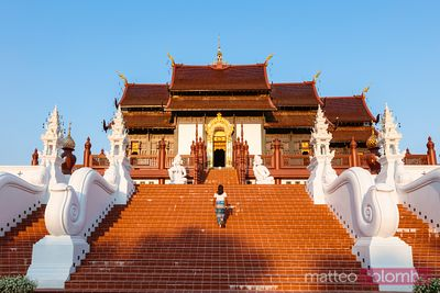 Woman walking on stairway, Royal park Rajapruek, Chiang Mai, Thailand
