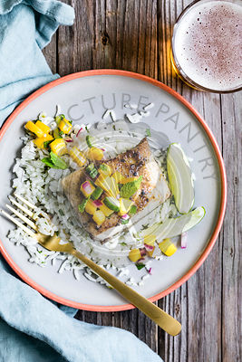 Pan fried fish with a mango salad topping