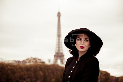 A vintage 1950's woman in a hat, in Paris