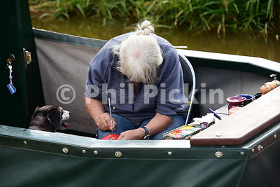 Artist working on her narrowboat
