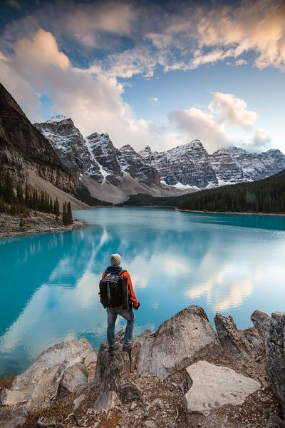 Hiker at Moraine lake at sunset, Banff, Canada