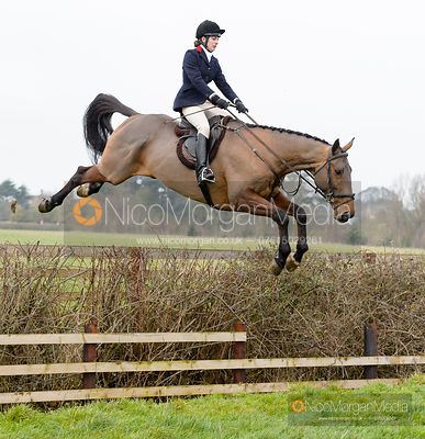 Ida Thore jumping a hedge near the meet
