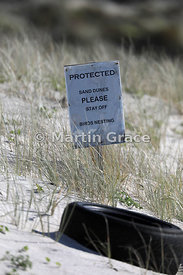 Warning sign protecting nesting area of North Island subspecies of New Zealand Dotterel (Charadrius obscurus aquilonius), Ota...